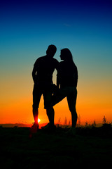 lovers silhouette at sunset