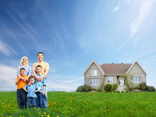 Happy family near new house.