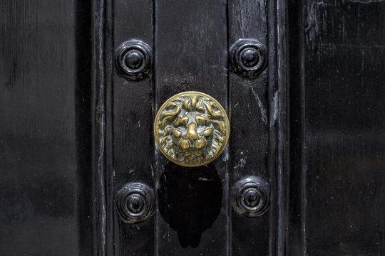 aged black door