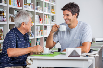 Father And Son Communicating While Having Coffee