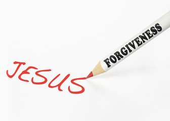 A forgiveness labeled pencil writing the word Jesus