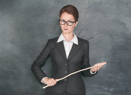 Strict teacher with wooden stick
