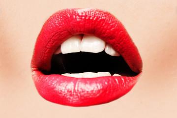 Beautiful female with red shiny lips closeup