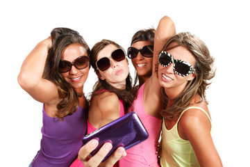 girls taking photo of herself with cellular phone
