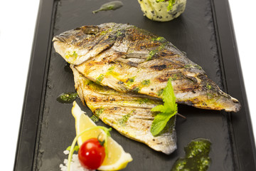 sea fish cooked on the grill
