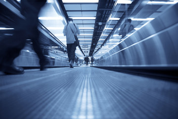 Movement of escalator with people walking