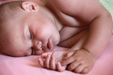 Sleeping Caucasian baby closeup portrait