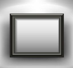Empty black picture frame on wall