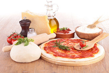 pizza dough with tomato sauce and ingredients