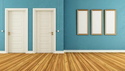 Empty blue room with doors