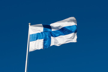 Garden Poster Scandinavia Flag of Finland before blue sky.