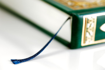 An macro image of the bookmark in the Quran