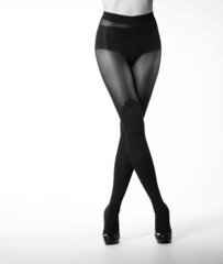 Black and white photo of sexy female legs in erotic stockings