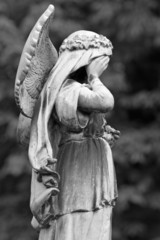 statue of crying cemetery angel , Ixelles Cemetery