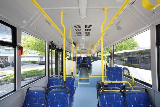 Blue seats inside saloon of empty city bus