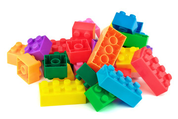 Toy colorful plastic blocks on white background