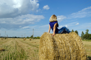 young blond woman girl teen sit straw bale