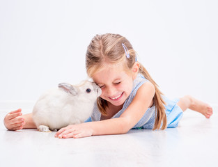 cute smiling girl with a white rabbit