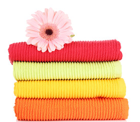 Colorful towels and flower, isolated on white