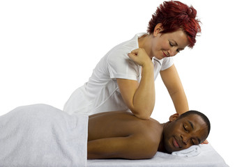 young female masseuse treating young male client with massage