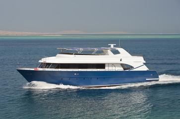 Large luxury motor yacht under way at sea