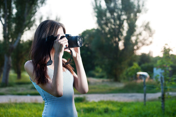 Beautiful girl with camera outdoor