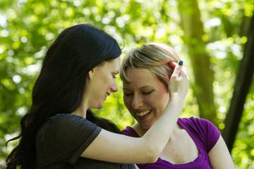 Affectionate lesbian couple, horizontal