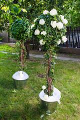 Stunning wedding decoration in the garden. Outdoor party decor