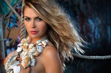 Portrait of seductive blond model with glamor makeup