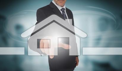 Businessman touching futuristic house interface