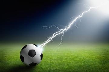 Soccer ball, lightning, spotlight
