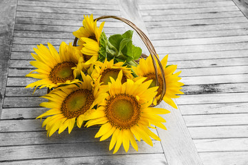 sunflowers in a basket on a table