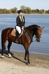 Horse and rider at riverside