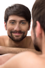 Man looking at mirror. Young man looking at himself at the mirro