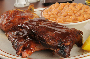 Barbecued ribs and chicken with baked beans
