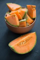 Vertical shot of sliced cantaloupe melon