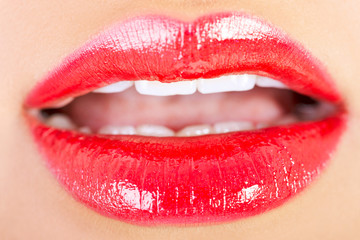 Closeup shoot of beautiful lips of woman with red lipstick