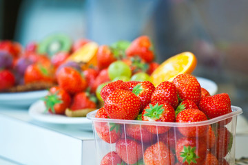 Berries of sweet strawberry in a plastic tray