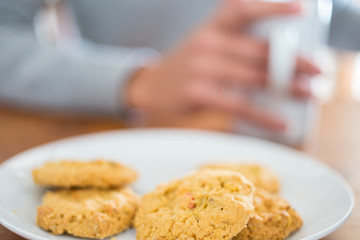 Cookies and woman holding a cup