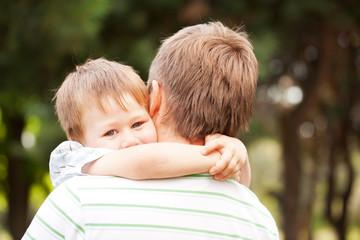 Child hugging daddy.