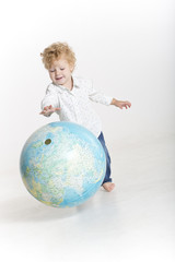 Happy young traveler holding the world