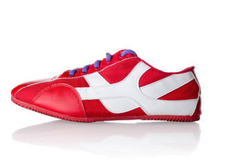 Red athletic sneaker with purple laces