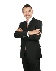 Handsome young business man standing with folded arms