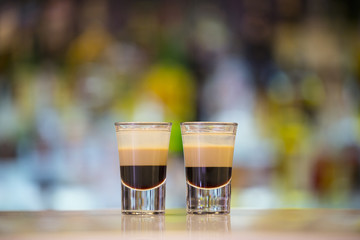Pair of B52 shots on a bar