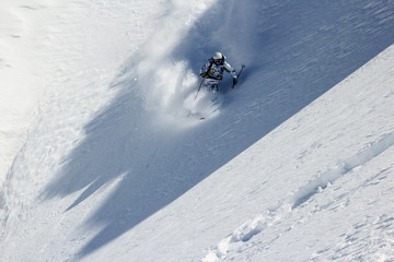 Skier on the edge of the light