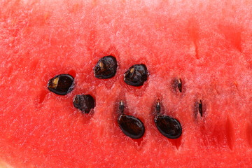 Macro shot of a watermelon with its seeds.