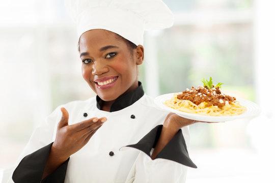 afro american chef presenting spaghetti