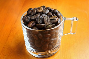 Wall Murals Coffee beans coffee beans in the glass for sale