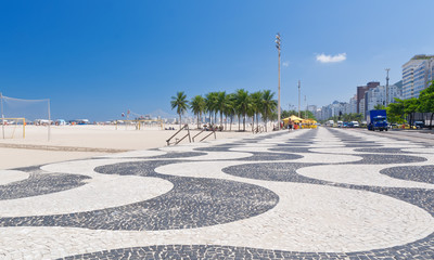 Copacabana with palms and mosaic of sidewalk in Rio de Janeiro