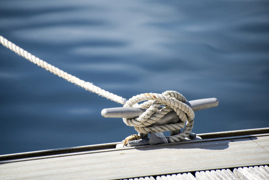 Detail image of yacht rope cleat on sailboat deck